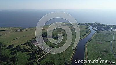 Ueckermunde city and harbor over the Szczecin reservoir stock footage