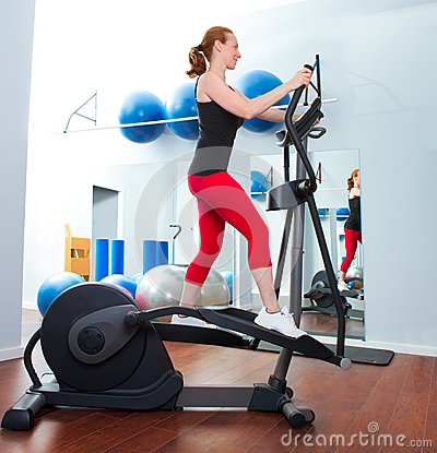 Aerobics cardio training woman on elliptic