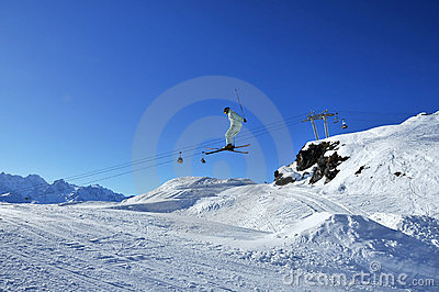 Aeroski: skier in pale green on jump