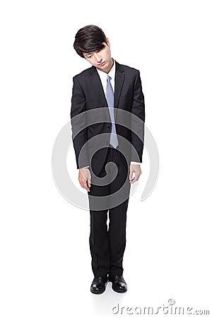 Affärsman som ser deprimerad från arbete