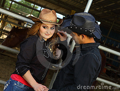 Affectionate Couple at a horse stabble