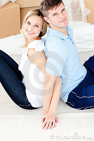 Affectionate couple sitting on the floor