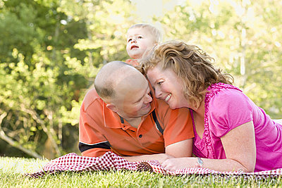Affectionate Couple with Son in Park