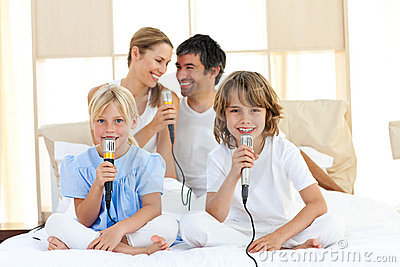 Affectionate Family Singing Together Royalty Free Stock Image - Image: 12810806