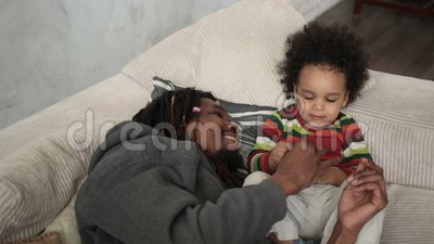 Affectionate father caressing curly son`s hair stock video footage