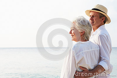 Affectionate Senior Couple On Tropical Beach Holiday