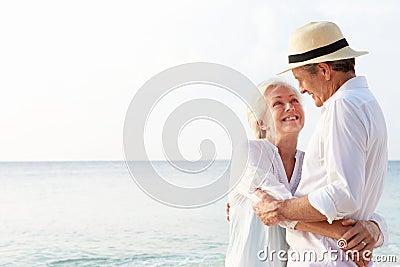 Affectionate Senior Couple On Tropical Beach Holiday