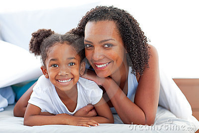 Affectionate woman and her daughter relaxing