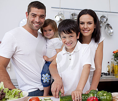 Affectionate young family cooking together