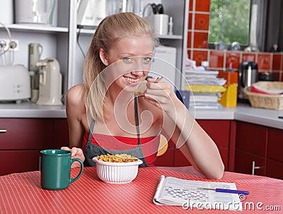 Affluent housewife having breakfast