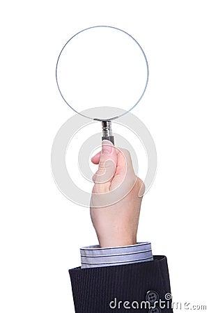 Affärsmanen räcker det hållande förstoringsglaset