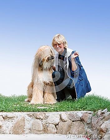 Afghan-dog and woman