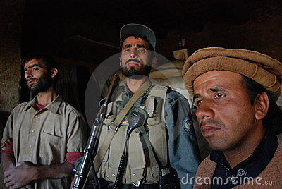 Afghan men in a bakeshop Editorial Stock Image