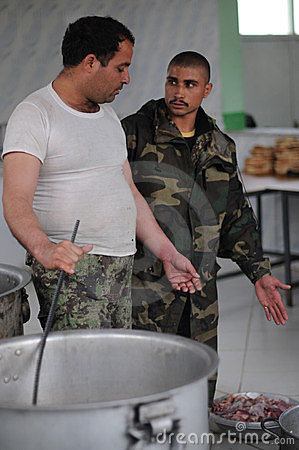 Afghan soldiers cooking a lunch Editorial Image