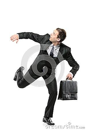 An afraid businessman running away