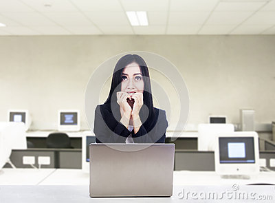 Afraid businesswoman with laptop at office
