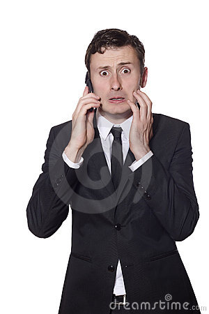 Afraid looking businessman with a phone