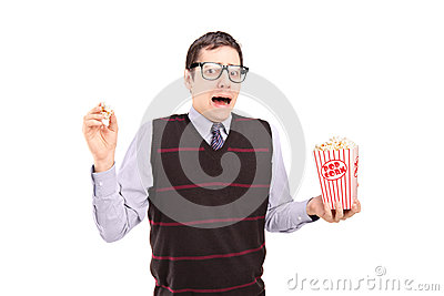 Afraid man holding a popcorn box