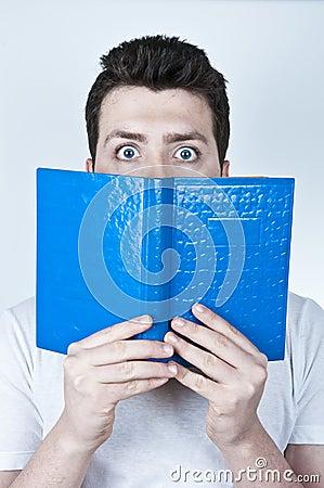 Afraid man reading a book