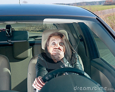 Afraid woman in the car