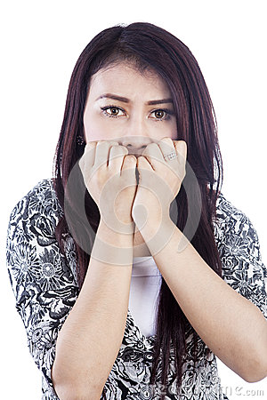Afraid woman isolated over white