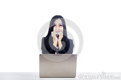 Afraid woman with laptop isolated over white
