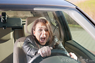 Afraid woman screaming in the car