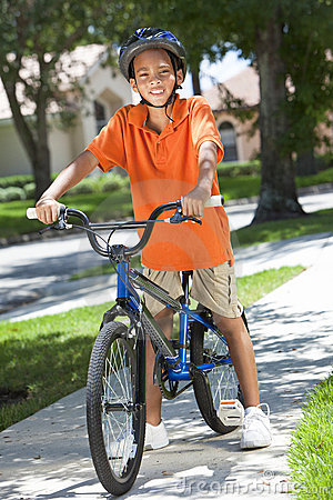 Free African American Boy Child Riding Bike Royalty Free Stock Photo - 21178345