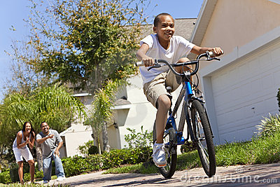 African American Boy Riding Bike & Happy Parents