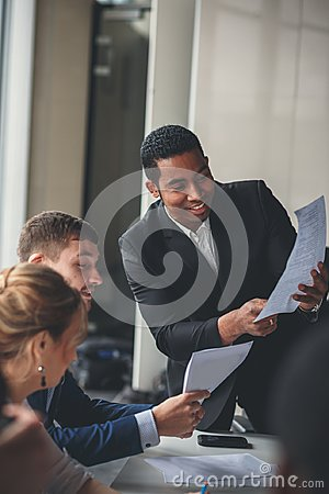Free African-American Business Leader In Working Environment Stock Images - 105065944