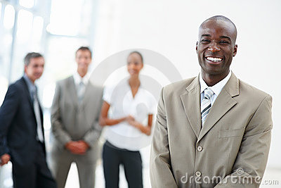 African American business man with coworkers