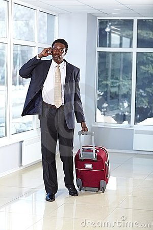 African American business man walking with bag