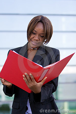 Free African American Business Woman With Folder Stock Photo - 8496210