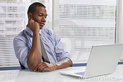 African American businessman at desk with computer, horizontal