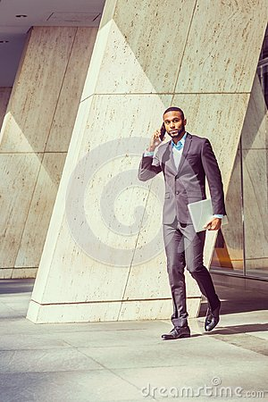 Free African American Businessman Talking On Cell Phone, Walking Out Royalty Free Stock Images - 100003959