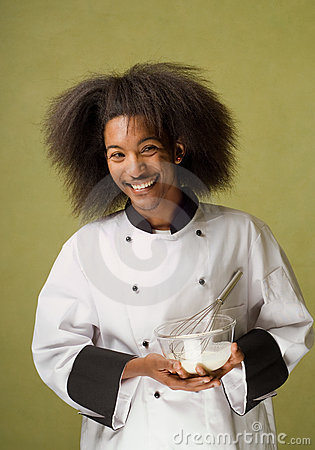 African American Chef Holding Bowl with Cream