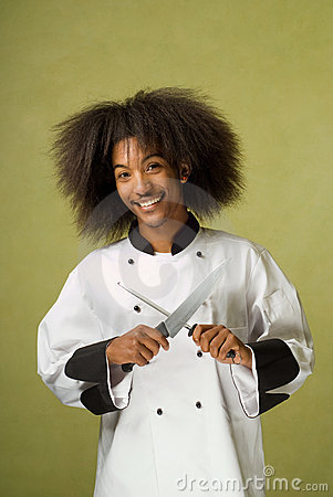 African American Chef Holding Knife and Sharpener