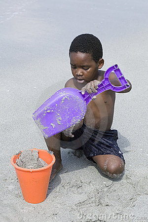 African American child plays at the beach