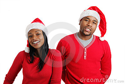 African american christmas couple with santa hats