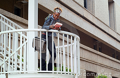 African American college student and stairway