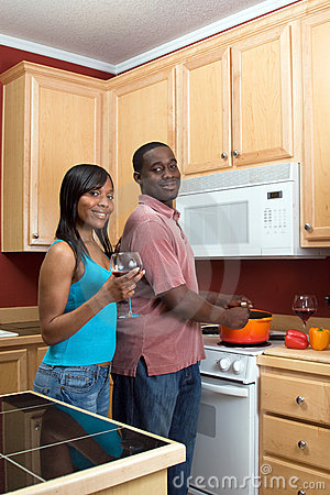 African American Couple Cooking - Vertical