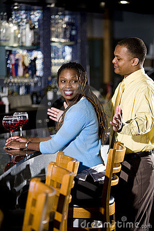 African American couple enjoying drinks at bar