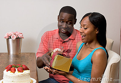 African american couple Exchanging Gifts
