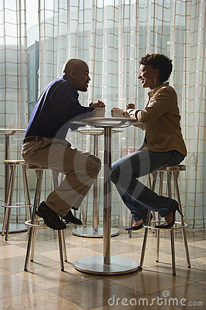 Free African-American Couple Having Coffee At Cafe Stock Photography - 12751452