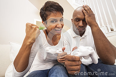 African American Couple Having Fun Playing Video Console Game Stock Photo