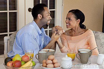 African American Couple Holding Hands At Breakfast