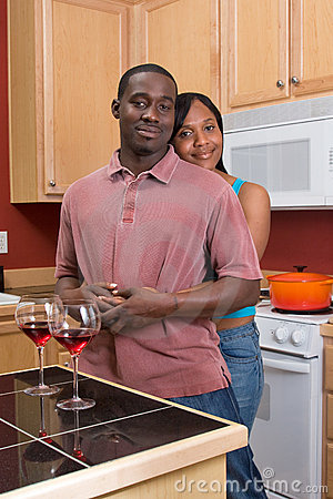 African American Couple Hugging in the Kitchen