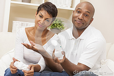African American Couple Playing Video Console Game Stock Photo