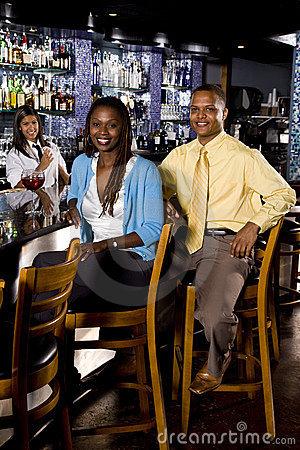 African American couple sitting at a bar