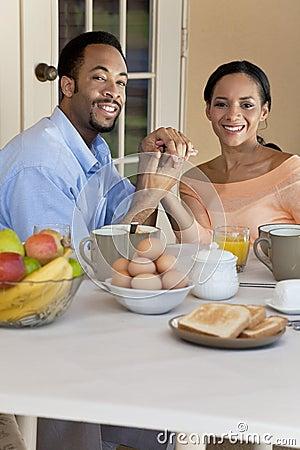 African American Couple Sitting Having Breakfast